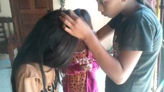 How to Finding Head louse by hand in Cambodia