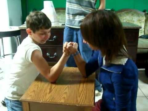 Girl beats boy in arm wrestling Super funny Round 2