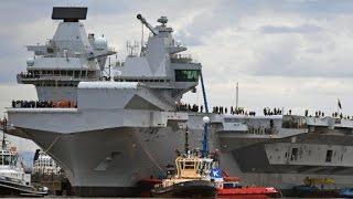 Massive new aircraft carrier navigates away from dock