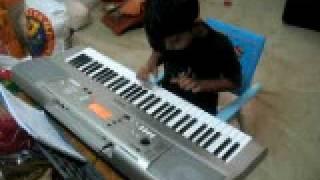 Kuttu playing keyboard