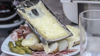 "French Raclette. Warm Melted Cheese on Ham and More Cooking at a ""Cheese Restaurant"""