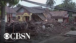 Tsunami triggered by volcanic eruption kills hundreds in Indonesia