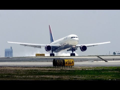 Busy airport landing and takeoff