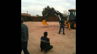 Backhoe picking up an egg in a spoon.MOV