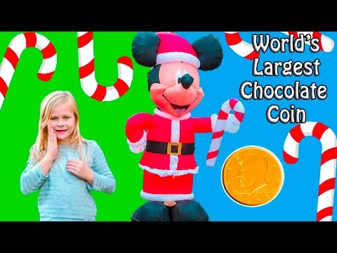 ASSISTANT Santa Mission to Find the Giant Chocolate Coin with Holiday Mickey Mouse Toys Video