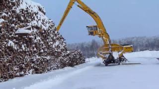 Sennebogen 870 M special  loading timber on truck