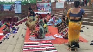 Desi woman meditating at the River Ganga