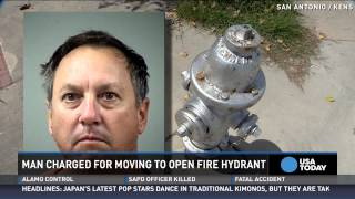 Man tries to open fire hydrant to save car, gets arrested