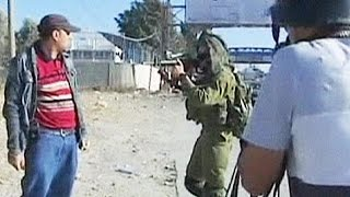 Video shows Israeli soldiers beating unarmed Palestinian demonstrator - no comment