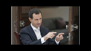 News Assad defies United States, presses assault in southwest Syria