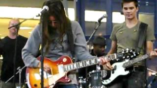 Ashley Tisdale playing guitar the mall of america 2009