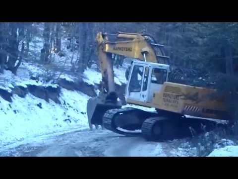 Excavator drifting on ice