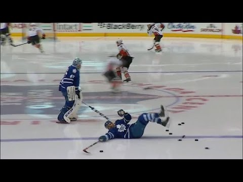Nazem Kadri slips on a puck in warm ups