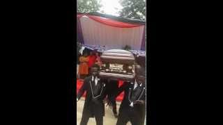 Pallbearers dance with coffin in a funeral in Ghana