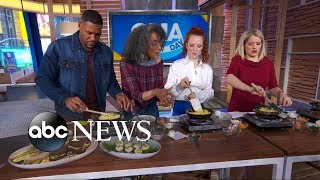 Carla Hall shows Michael, Sara and Jess Glynne how to make the perfect omelet