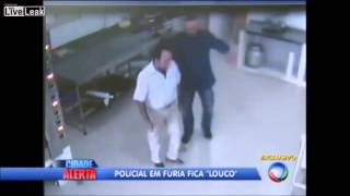 Lunatic cop forces business man to kiss the feet of employees