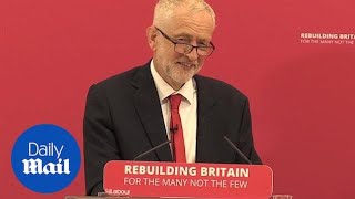 Jeremy Corbyn smirks as journalists are heckled at speech in Corby