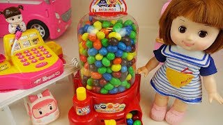 Candy dispenser and Mart Baby doll surprise eggs toys play