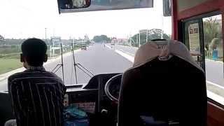ENa BM boy running on smooth DHAKA-MYMENSINGH highway