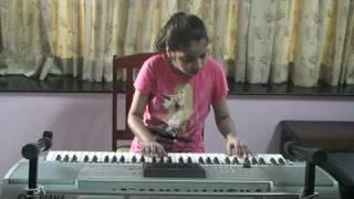 Nandini playing on keyboard... Bengali song Hai Rama... from film Amanush...