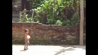 Nepali Messi (Nepali Pele) in the Making: A little boy plays football in Kathmandu alley