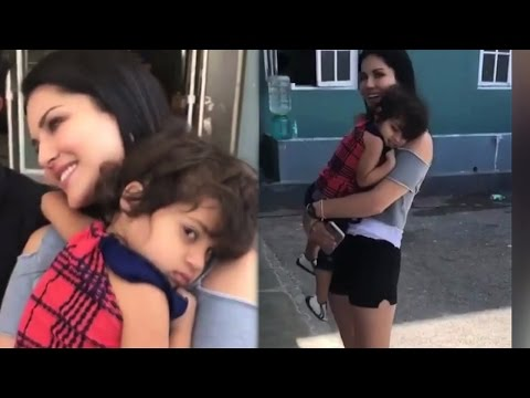 Sunny Leone's Cute Moment With Little Girl Fan !!