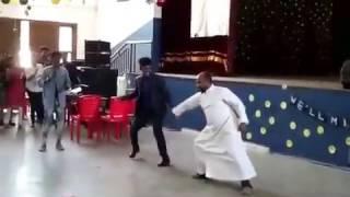 Baha Kilikki dance by a Priest.