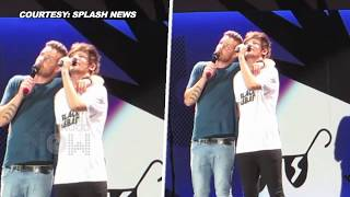 (Watch) Liam Payne KISSES Louis Tomlinson Accidentally On Stage
