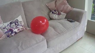 Sitting on a balloon to pop it