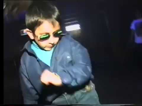 Russian kid dancing  at club can't be bothered. 1997.