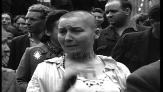 A Frenchman shaves hair of women collaborators on the streets in Besancon, France...HD Stock Footage