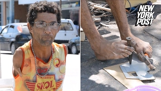 Armless man uses his feet to make toy cars