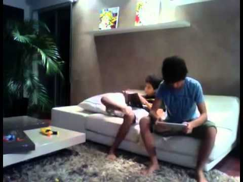boy slaps his brother with the ipad