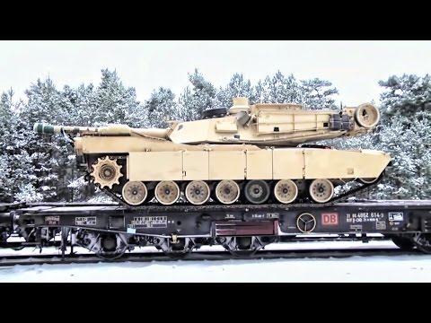 watch U.S. Heavy Combat Vehicles Arrive In Poland