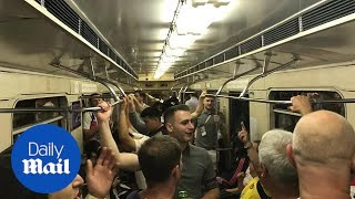 England fans chant on the Moscow metro on their way to the game