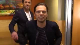 Robert Downey, Jr kisses Sebastian Stan
