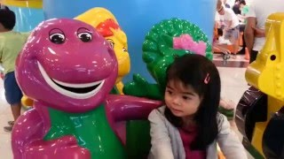 Riding a car with Barney and friends