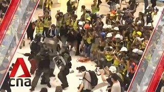 Hong Kong Police And Protesters Clash Inside Shopping Mall