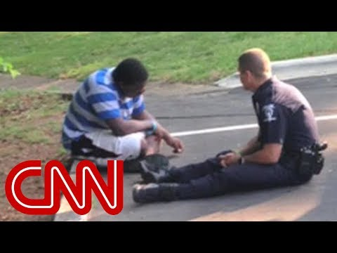 Xxx Mp4 Photo Of Police Officer Consoling Teen Goes Viral 3gp Sex