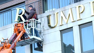 Trump signs removed from some NYC buildings