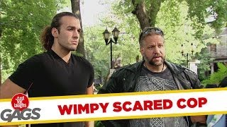 Wimpy Cop Scared of Tough Men