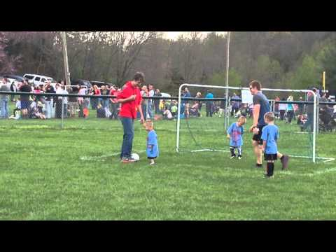 3 year old's first soccer game attacking referee