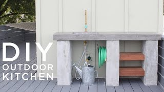 DIY Outdoor Kitchen with Concrete countertops and sink