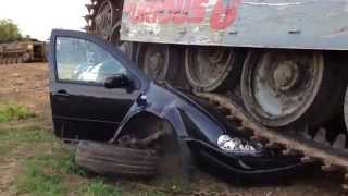 VW golf ruined by tank.  That won't drive again.