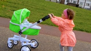 Little Girl Pushing Toy Pram/ Playing with Baby Doll /Outdoor Playground