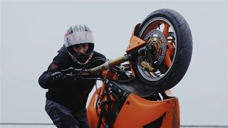 Crazy Russian doing Motorcycle Stunts on a Very High Building