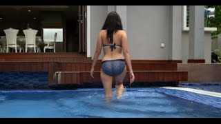 Model in swimming pool