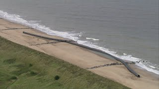 Gigantic pipes wash up on Norfolk beaches