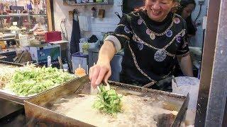 Pancake of Fried Oysters. Strange Chinese Street Food of Hong Kong