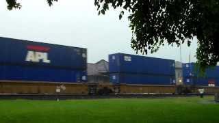 Three Trains at Deshler, OH in the Rain; CSX Spirit of Dante, NS SD70ACe Pair, BNSF GEVO